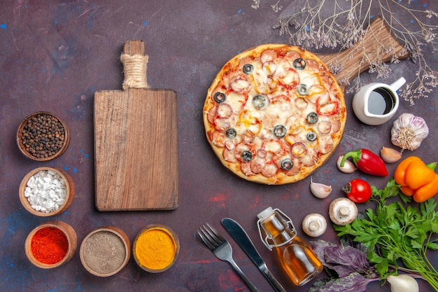 Top view delicious mushroom pizza with cheese olives and seasonings on the dark surface pizza meal italian food dough snack