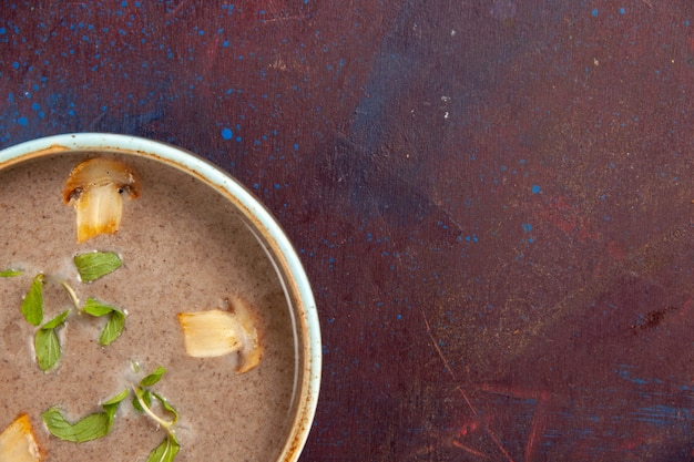 Top view delicious mushroom soup inside plate on dark-purple desk