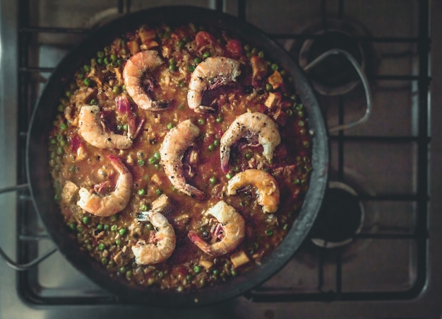 Top view of a delicious paella dish