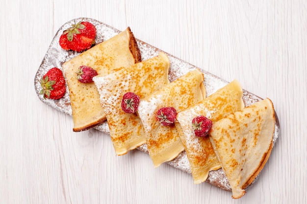 Top view delicious pancakes with fruits on white background sweet cake dessert fruits tea pancake