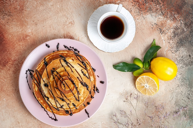 Top view on delicious pancakes with various ingredients