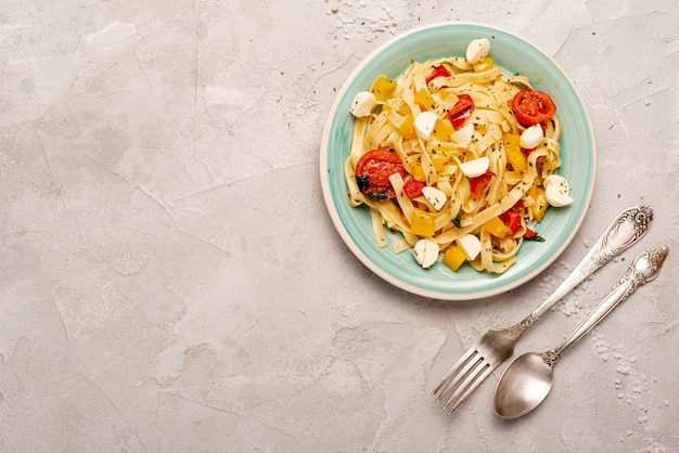 Top view of delicious pasta with copy space