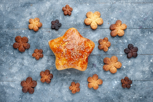 Top view of delicious pastry star shaped with cookies on light, sweet bake pastry sugar cake