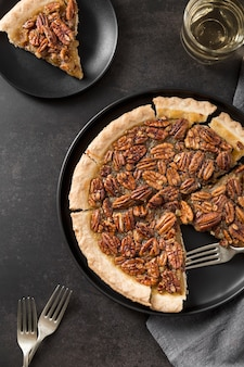 Top view delicious pecan pie with crust on the table