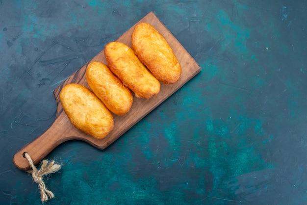 上面図濃紺の背景に肉を詰めたおいしいパイ生地生地パイパンパン食品