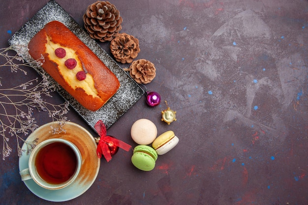 Top view delicious pie with cup of tea on dark background cake sugar cookie pie sweet biscuit tea
