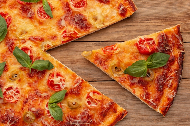 Top view delicious pizza on wooden background