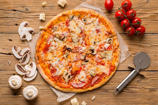 Top view of delicious pizza on wooden table