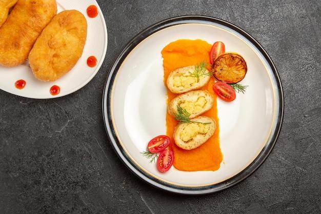 Top view delicious potato hotcakes with potato pie slices and pumpkin on dark background hotcake pie cake bake oven