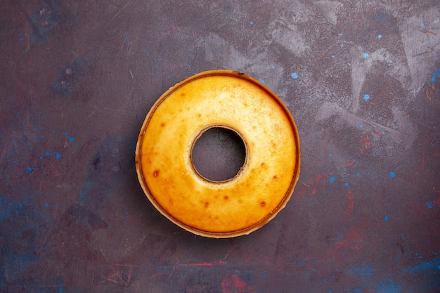 Top view delicious round cake perfect sweet pie for tea on a dark background tea biscuit sweet pie sugar dough cake