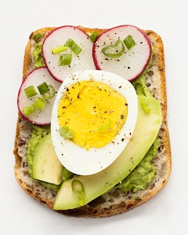 Top view of delicious sandwich with egg and avocado