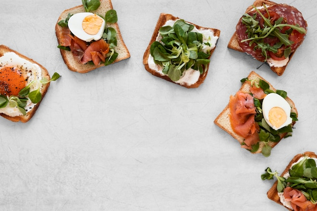 Top view delicious sandwiches arrangement with copy space