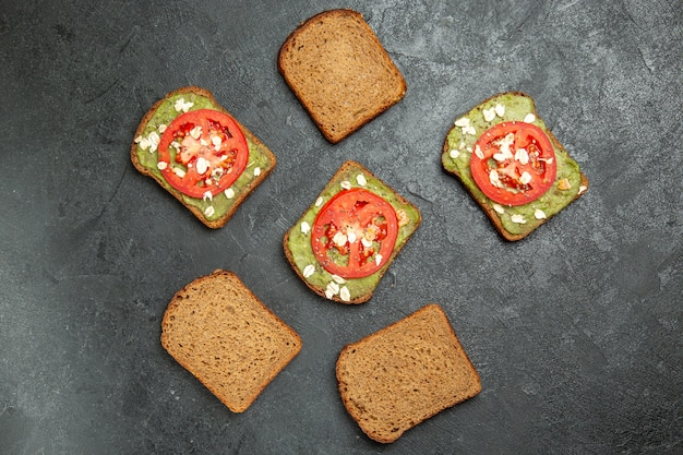 Top view delicious sandwiches with wassabi and red tomatoes on the grey background meal burger sandwich snack bread