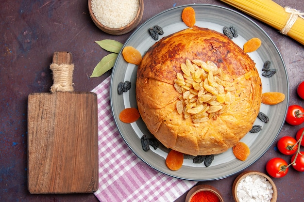 Top view delicious shakh plov eastern meal consists of cooked rice inside round dough on the dark background dough meal food rice