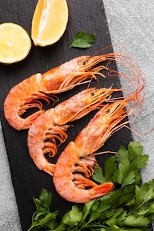 Top view delicious shrimp dish with lemon