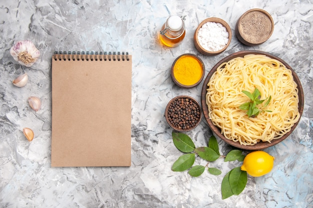Top view delicious spaghetti with seasonings on white table meal dish pasta