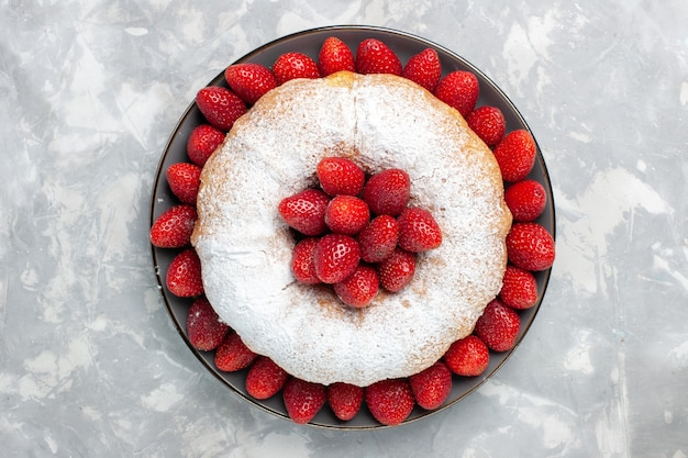 Top view delicious strawberry pie with sugar powder on a white