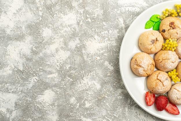 Top view delicious sugar cookies inside plate on white desk sugar cookies sweet biscuit tea cake