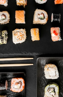 Top view delicious sushi on desk
