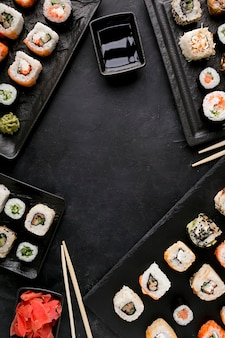 Top view delicious sushi and sauce