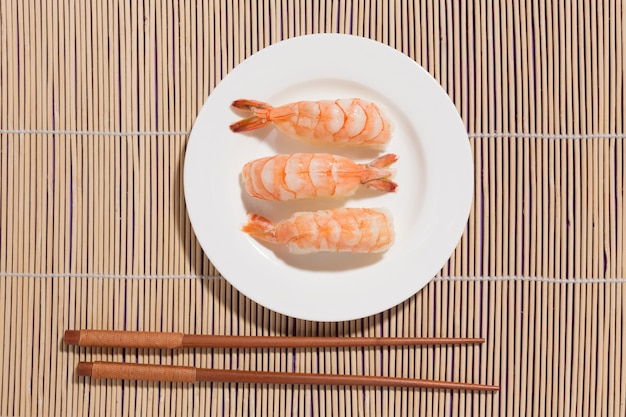 Top view delicious sushi with chopsticks
