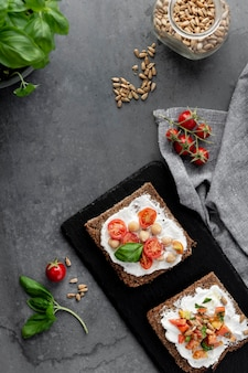 Top view delicious toast slices with cherry tomatoes