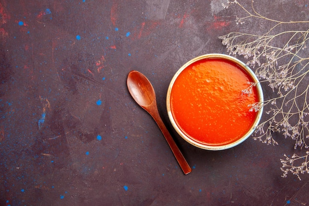 Top view delicious tomato soup cooked from fresh tomatoes on dark background sauce meal tomato dish soup