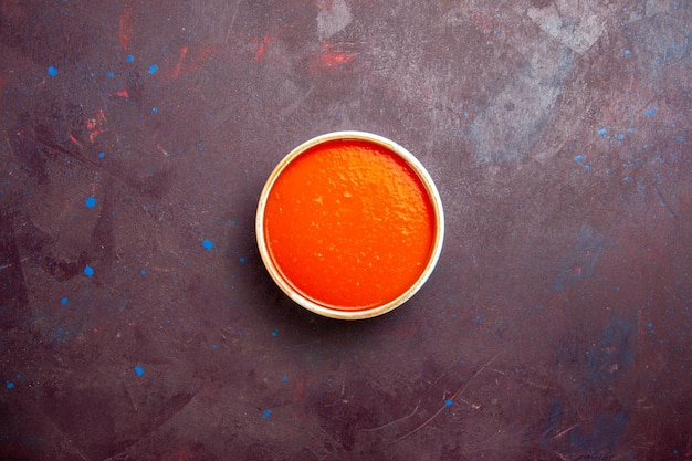 Top view delicious tomato soup cream textured made from fresh tomatoes on dark background sauce soup dish meal tomato