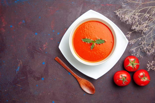 Top view delicious tomato soup tasty dish with single leaf inside plate on dark background dish sauce tomato color soup meal