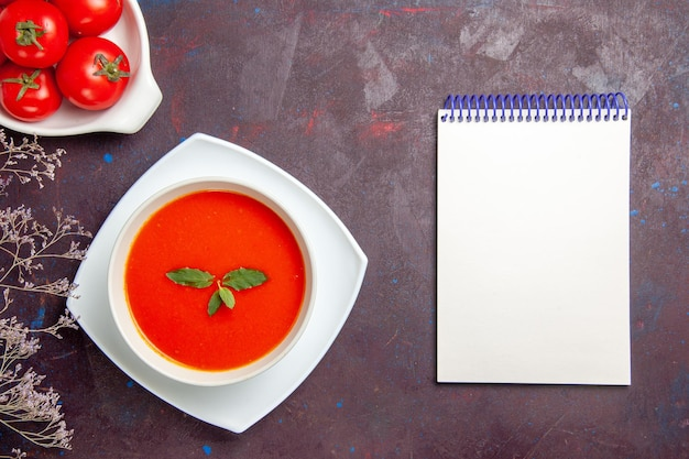 Top view delicious tomato soup with fresh tomatoes on a dark background dish sauce tomato color meal soup