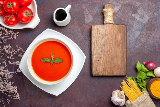 Top view delicious tomato soup with fresh tomatoes on dark background dish sauce tomatoes color meal soup