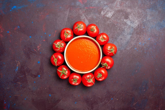 Top view delicious tomato soup with fresh tomatoes on a dark background tomatoes dish dinner soup sauce meal