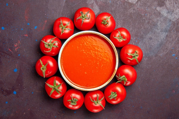 Top view delicious tomato soup with fresh tomatoes on dark background tomatoes dish dinner soup sauce meal