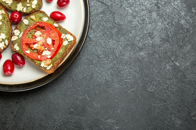 Top view delicious useful sandwiches with avocado pasta and tomatoes inside plate on grey background burger sandwich bread snack