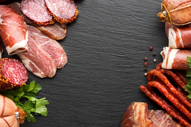 Top view delicious variety of meat with copy space