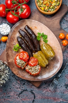 Top view delicious vegetable dolma with salad and tomatoes, health food dinner color dish cuisine