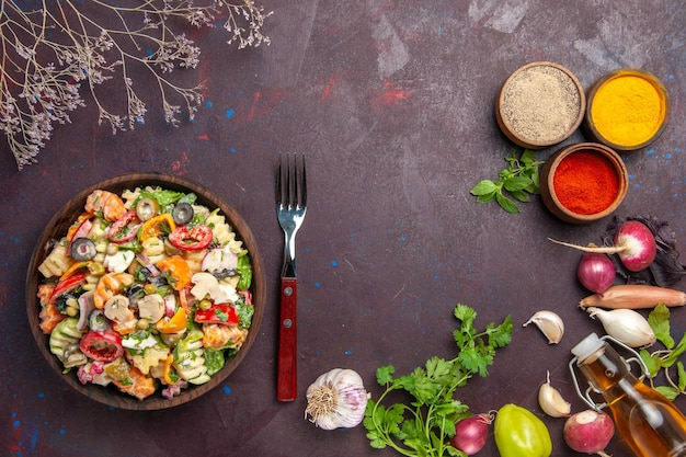 Top view delicious vegetable salad with different seasonings on a dark background health vegetable diet lunch salad