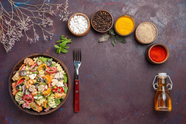 Top view delicious vegetable salad with different seasonings on dark purple background health diet vegetable salad lunch