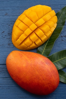 Top view design concept of beautiful mango over blue table background.