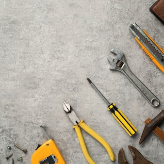 Top view design concept of father's day and labor day with working tools on blue background