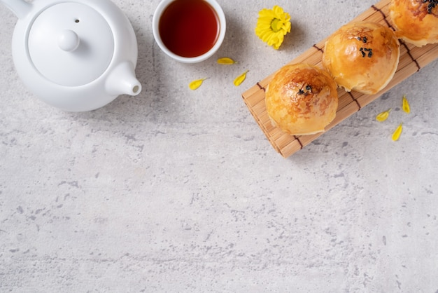 Top view design concept of moon cake yolk pastry, mooncake for mid-autumn festival holiday on dark gray table background