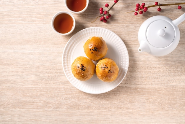 Top view design concept of moon cake yolk pastry, mooncake for mid-autumn festival holiday on wooden table background
