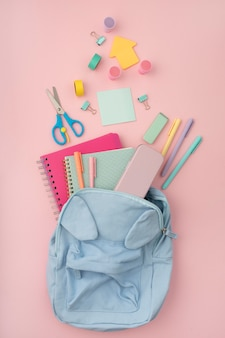 Top view desk arrangement with backpack