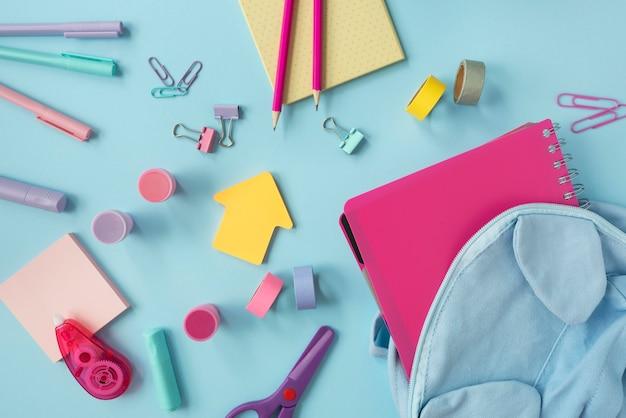 Top view desk arrangement with school supplies