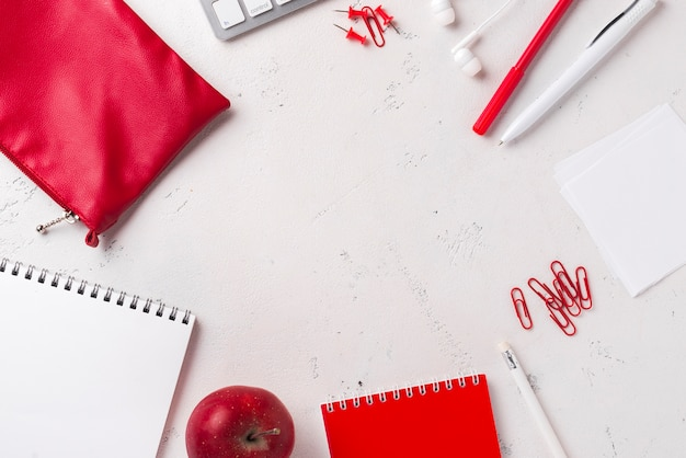 Top view of desk with apple and stationery