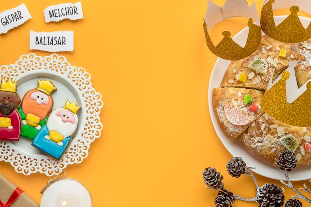 Top view of dessert with presents and three kings on plate for epiphany day