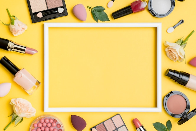 Top view different beauty products arrangement with empty frame