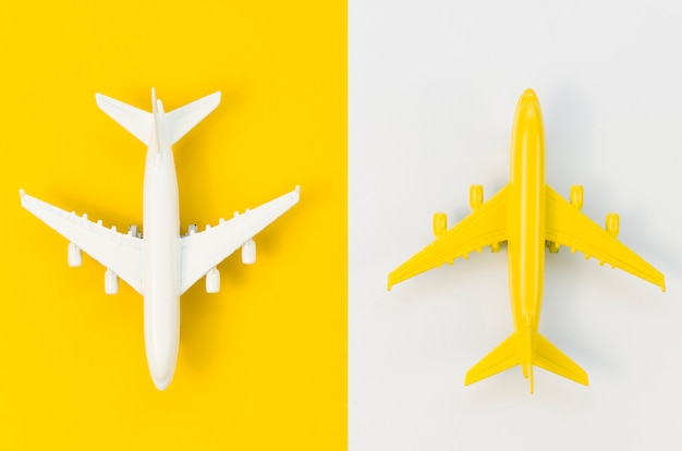Top view different colored airplane toys