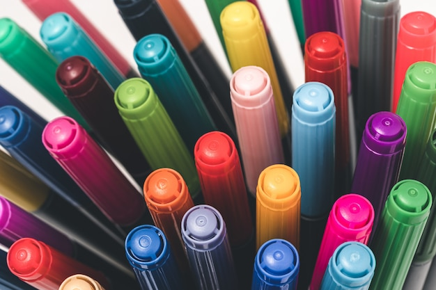 Top view of different colored markers. close-up markers of many colors.