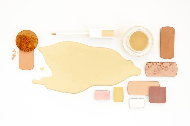 Top view different cosmetics on white background